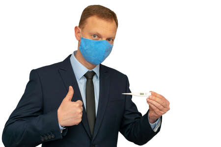 The man in a medical mask and with thermometer showing thumb up because temperature 36.6