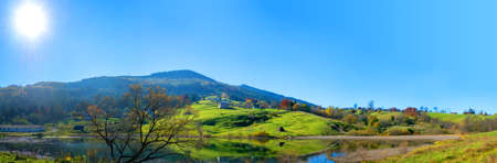 Panoramic view of Carpathian Mountains. Green hills with pine-trees and lake. Active rest in mountains. Beautiful nature of Ukraine. Carpathians, Ukraine.