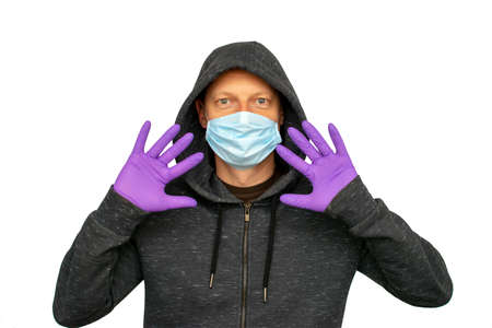 Man was defending himself and fighting the corona virus and other diseases by wearing gloves and hygiene mask. Standard-Bild