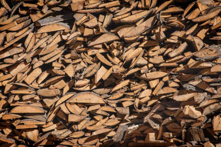 A pile of firewood, firewood wall of an old wooden house, preparation of firewood for the winter. Standard-Bild