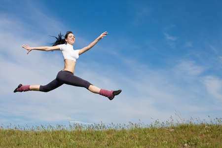 Attractive young woman jumping on open air  Brunette jumps on background of sky Stock Photo - 13348306