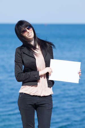Attractive brunette in black on background of sea Stock Photo - 13646493