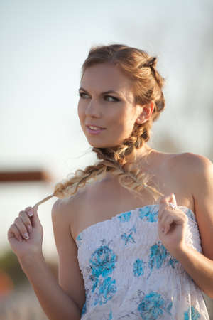 open air: Girl in sundress. Portrait of woman with pigtails on open air
