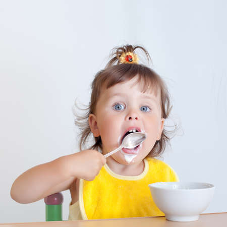 Charming toddler eats. Little girl eats
