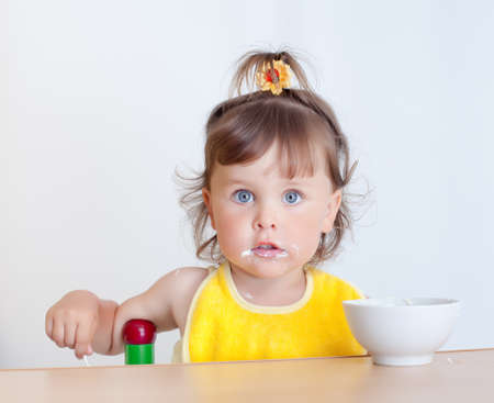 Charming toddler eats. Little girl eats