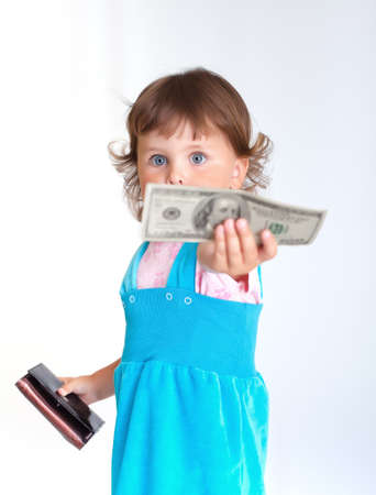 Young buyer. Little girl holds one hundred dollars US