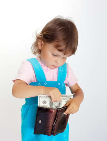 one hundred dollars: Young buyer. Little girl takes one hundred dollars US