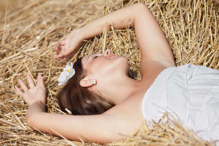 hayloft: Girl sleeping on a hayloft Stock Photo