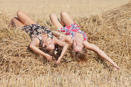 hayloft: Two girls lying on hayloft