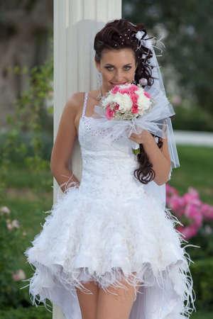 Attractive bride in the park  Bride posing looking at camera smiling