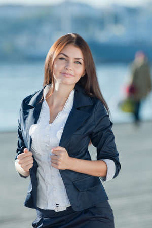open air: Attractive long haired brunette on open air  Portrait of young businesswoman outdoors Stock Photo