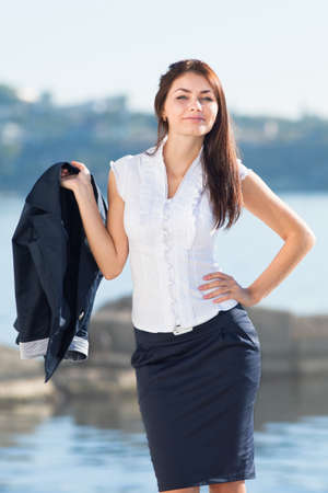 skirt up: Attractive long haired brunette on open air  Portrait of young businesswoman outdoors Stock Photo