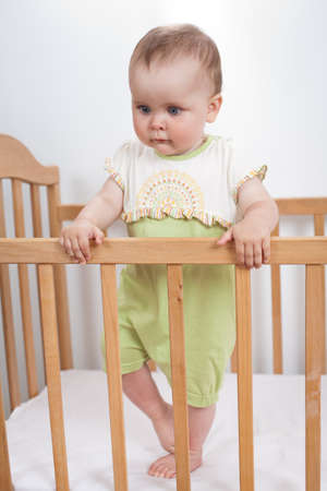 6 12 months: Charming baby indoor  Baby girl in child bed