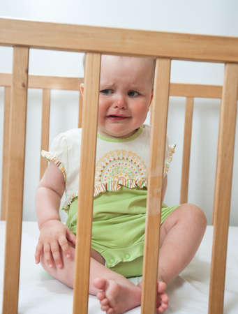 rompers: Charming baby indoor  Baby girl in child bed