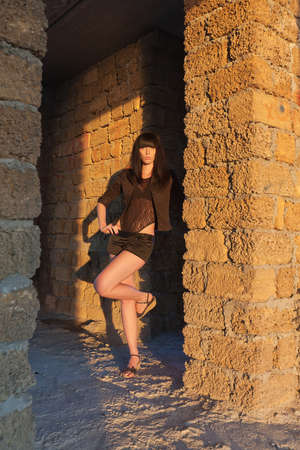 Attractive dark haired girl  Attractive brunette in black among the ruins Stock Photo - 17992166