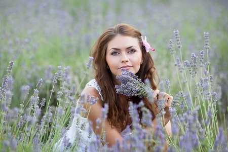 non urban 1: Young woman in white outdoors  Attractive girl in the field of blossoming lavender