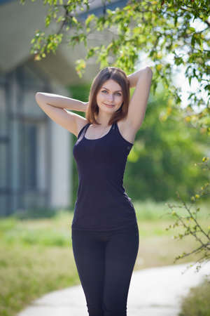 colleen: Portrait of attractive young woman outdoors  Slender girl in black on open air