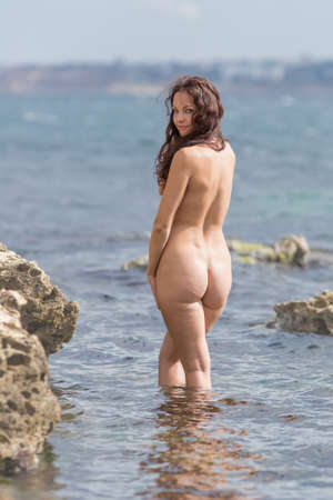 nude outdoors: Nude young woman pose at the sea