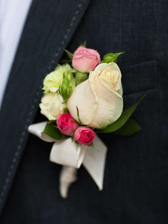 Boutonniere on groom photo