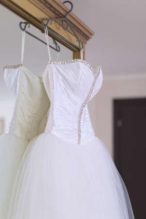 Wedding lifestyle  Wedding dress on mirror wardrobe  photo