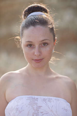 eastern european ethnicity: Portrait of girl outdoors  Young woman in white sundress looking at camera