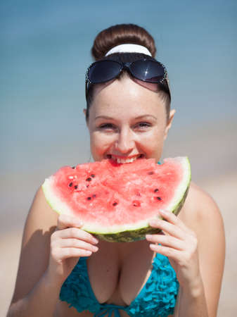 Girl with watermelon  Young woman eats watermelon outdoors photo