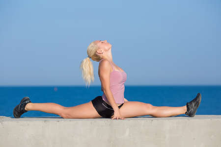 Gymnastic Twine. Healthy woman doing stretching photo