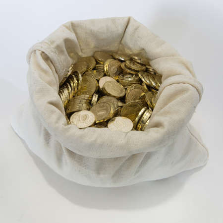 abundant: Bag of coins on white. Sack with full russian coin of 10 rubles in it