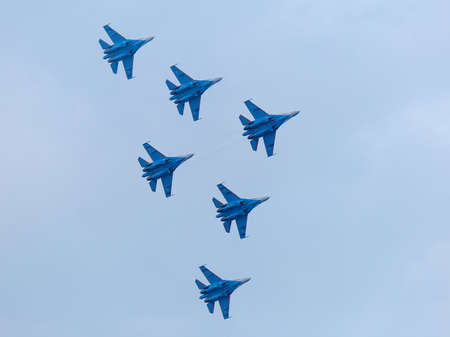 Six war jet planes in sky. Russian military jet planes showing aerobatics