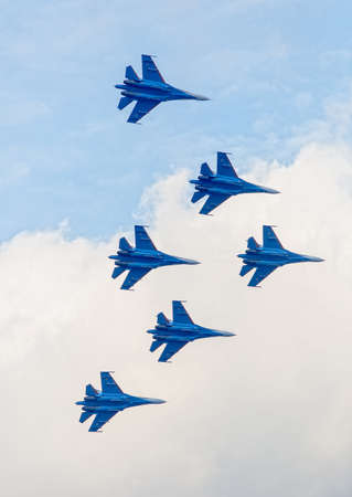 modern fighter: Six war jet planes in sky. Russian military jet planes showing aerobatics Editorial