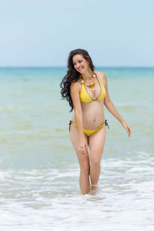 expectant mother: Expectant mother emerging from the sea. Stock Photo