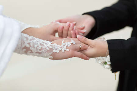newly wedded couple: Hands of newly wedded with wedding rings Stock Photo