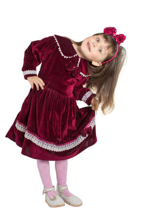 velvet dress: Portrait of preschooler girl in velvet dress. Charming child posing on white background indoors. Studio shot. Isolate on white Stock Photo