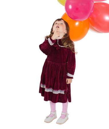 velvet dress: Portrait of preschooler girl in velvet dress. Charming child with air baloons posing on white background indoors. Studio shot. Isolate on white