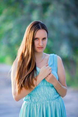 in the open air: Girl in the park. Young woman without makeup posing on open air