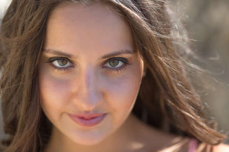 in the open air: Portrait of girl on open air. Young woman looking at camera, close-up Stock Photo
