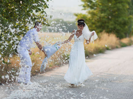 pillow fight: Pillow Fight. Bridal couple playing with feathers