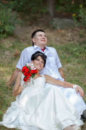 newly wedded couple: Newly wedded couple in the park. Just married in day of them wedding Stock Photo