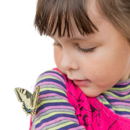 machaon: Child and butterfly. Portrait of preschooler girl with papilio machaon