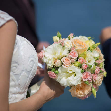 square composition: Bridal bouquet. Beautiful nosegay in hand of bride. Square composition