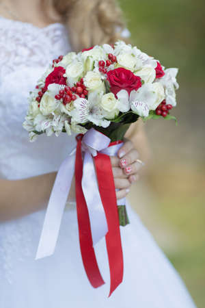 Bridal bouquet. Beautiful nosegay in hands of bride Stock Photo