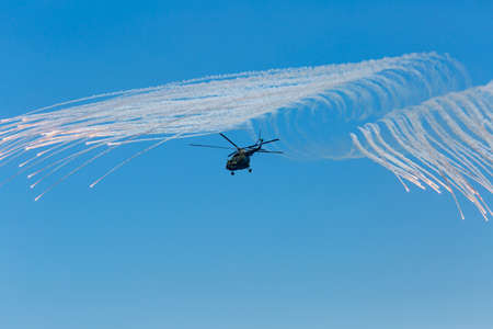aerobatics: Helicopter Mi-8 in sky. Russian military helicopter Mi-8 launches anti-missiles in time of military show