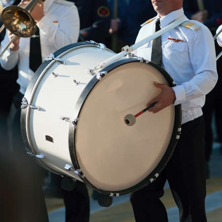 Drummer in a Marching Band. Drummer plays big drum in parade Standard-Bild