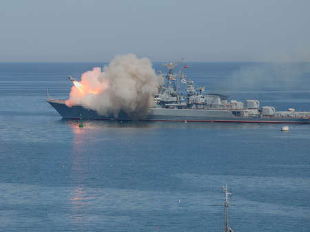 Missile flying in sky. Running anti-ship missile from warship