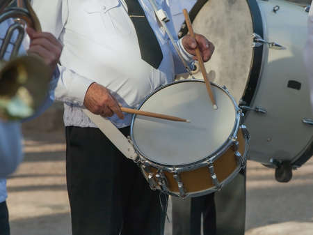 snare drum: Drummer in a Marching Band. Drummer plays snare drum in parade Stock Photo