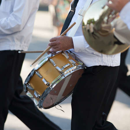 in unison: Drummer in a Marching Band. Drummer plays snare drum in parade Stock Photo
