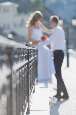 Wedding couple on a walk. Newly wedded couple on seafront on a summer day 스톡 콘텐츠