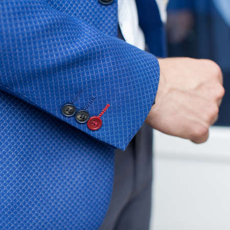 Mans hand in his jacket. Three stylish buttons at cuff jacket Stok Fotoğraf