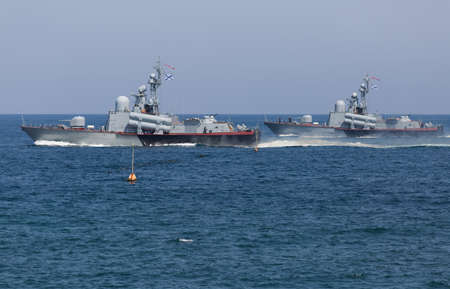 Two naval ships in the sea. Two naval ships on Day of Russian Navy in sea off the coast of Sevastopol Stock Photo