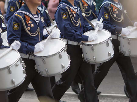 Drummers in a Marching Band. Navy orchestra participate in parade.